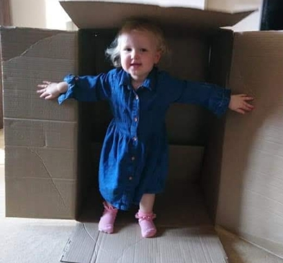 Toddler in a box.